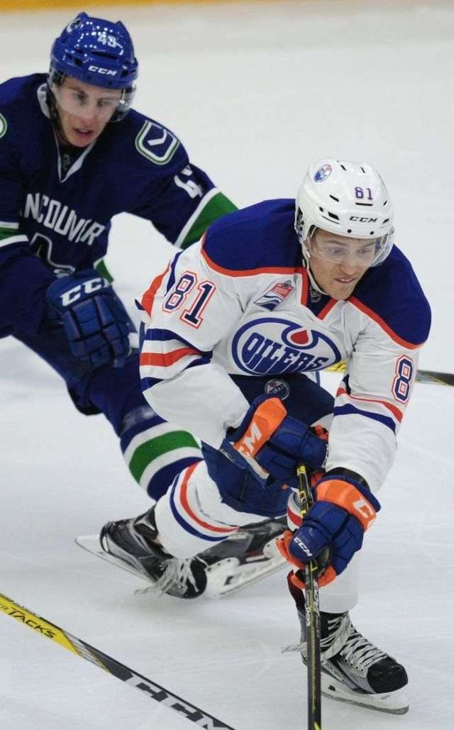 Vancouver Canucks' Curtis Valk (43) chases Edmonton Oilers' Caleb Jones (81) during third period 2016 NHL Young Stars Classic action at the South Okanagan Events Centre in Penticton, BC., September 16, 2016.