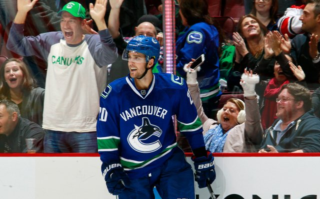 VANCOUVER, BC - OCTOBER 16: Brandon Sutter #20 of the Vancouver Canucks celebrates after scoring in overtime against the Carolina Hurricanes during their NHL game at Rogers Arena October 16, 2016 in Vancouver, British Columbia, Canada. Vancouver won 4-3 in overtime. (Photo by Jeff Vinnick/NHLI via Getty Images)