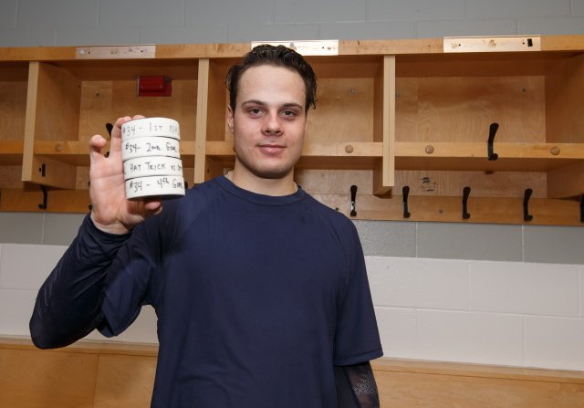 OTTAWA, ON - OCTOBER 12: Making his NHL debut, Auston Matthews #34 of the Toronto Maple Leafs poses with the 4 pucks with which he scored his first career NHL goals after a game against the Ottawa Senators during the season opener at Canadian Tire Centre on October 12, 2016 in Ottawa, Ontario, Canada.  (Photo by Andre Ringuette/NHLI via Getty Images)