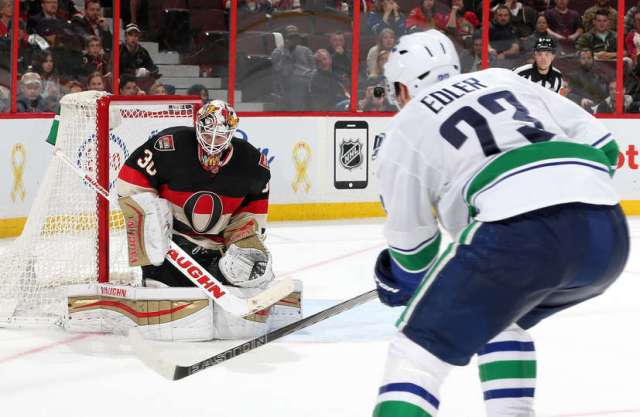 OTTAWA, ON - NOVEMBER 12: Alexander Edler #23 the Vancouver Canucks scores a third period goal against Andrew Hammond #30 of the Ottawa Senators during an NHL game at Canadian Tire Centre on November 12, 2015 in Ottawa, Ontario, Canada. (Photo by Jana Chytilova/Freestyle Photography/Getty Images)
