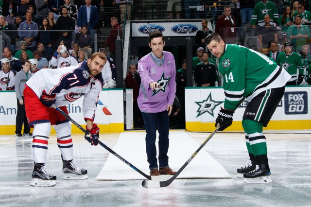 DALLAS, TX - OCTOBER 22: Trevor Strader, son of Dallas Stars play-by-play announcer Dave Strader who is currently battling cancer, drops the puck between Nick Foligno #71 of the Columbus Blue Jackets and Jamie Benn #14 of the Dallas Stars as part of Hockey Fights Cancer night at the American Airlines Center on October 22, 2016 in Dallas, Texas. (Photo by Glenn James/NHLI via Getty Images)