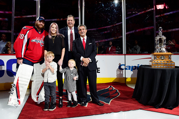 WASHINGTON, DC - OCTOBER 18: (L to R) Braden Holtby #70 of the Washington Capitals, wife Brandi,son Benjamin, daughter Belle, Capitals president Dick Patrick, and owner Ted Leonsis stand on the ice during a presentation honoring Holtby's 48 wins and winning the Vezina Trophy for 2015-2016 prior to the Capitals game against the Colorado Avalanche at Verizon Center on October 18, 2016 in Washington, DC. (Photo by Patrick McDermott/NHLI via Getty Images)