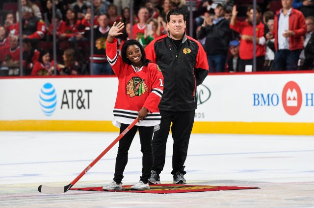 CHICAGO, IL - OCTOBER 12:  Olympic gold medalist Simone Biles shoots the puck in between periods of the game between the Chicago Blackhawks and the St. Louis Blues during the season opener at the United Center on October 12, 2016 in Chicago, Illinois.  (Photo by Bill Smith/NHLI via Getty Images)