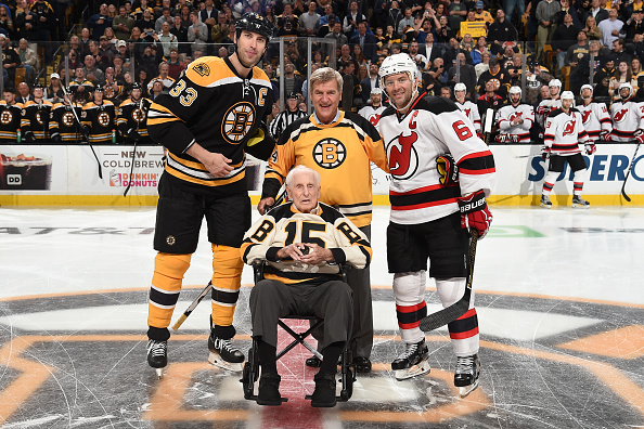BOSTON, MA - OCTOBER 20 : Zdeno Chara #33 of the Boston Bruins and Andy Greene #6 the New Jersey Devils pose with alumni players Bobby Orr and Milt Schmidt before the season opener at the TD Garden on October 20, 2016 in Boston, Massachusetts.  (Photo by Steve Babineau/NHLI via Getty Images)
