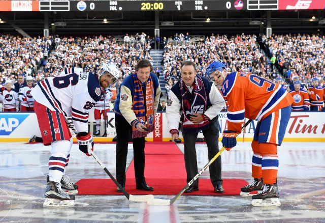 WINNIPEG, MB - OCTOBER 23:  (L-R) Blake Wheeler #26 of the Winnipeg Jets, Edmonton Oilers alumni Wayne Gretzky, Winnipeg Jets alumni Dale Hawerchuk and Connor McDavid #97 of the Edmonton Oilers pose while participating in the ceremonial puck drop to start of the 2016 Tim Hortons NHL Heritage Classic between the Edmonton Oilers and the Winnipeg Jets at Investors Group Field on October 23, 2016 in Winnipeg, Canada.  (Photo by Andy Devlin/NHLI via Getty Images)