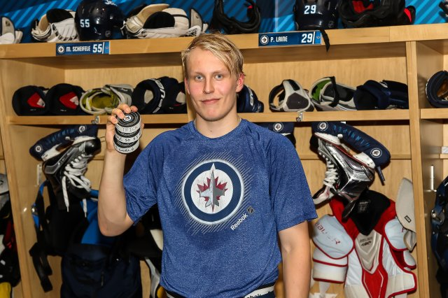 WINNIPEG, MB - OCTOBER 19: Patrik Laine #29 of the Winnipeg Jets poses with his pucks after scoring his first career NHL hat trick in a 5-4 overtime win over the Toronto Maple Leafs at the MTS Centre on October 19, 2016 in Winnipeg, Manitoba, Canada. (Photo by Jonathan Kozub/NHLI via Getty Images)
