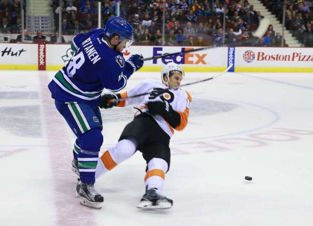 VANCOUVER, BC - NOVEMBER 2: Jake Virtanen #18 of the Vancouver Canucks hits Brayden Schenn #10 of the Philadelphia Flyers during their NHL game at Rogers Arena November 2, 2015 in Vancouver, British Columbia, Canada. Vancouver won 4-1. (Photo by Jeff Vinnick/NHLI via Getty Images)