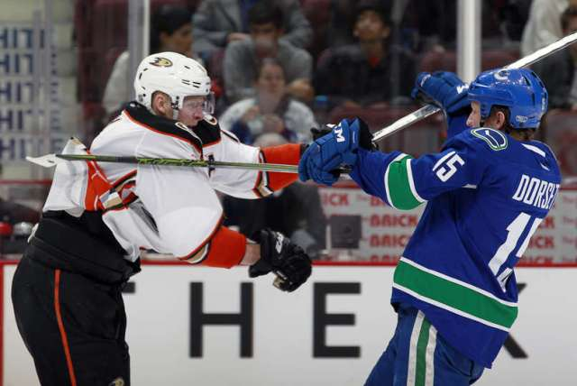 VANCOUVER, BC - FEBRUARY 18: Corey Perry #10 of the Anaheim Ducks and Derek Dorsett #15 of the Vancouver Canucks spar during their NHL game at Rogers Arena February 18, 2016 in Vancouver, British Columbia, Canada. Anaheim won 5-2. (Photo by Jeff Vinnick/NHLI via Getty Images)