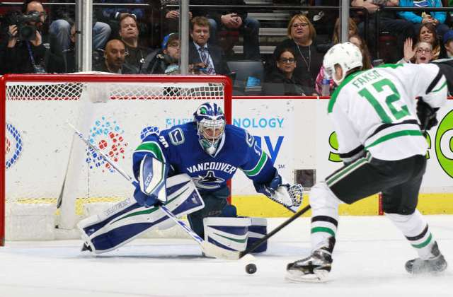VANCOUVER, BC - NOVEMBER 13: Ryan Miller #30 of the Vancouver Canucks stops Radek Faksa #12 of the Dallas Stars on a breakaway during their NHL game at Rogers Arena November 13, 2016 in Vancouver, British Columbia, Canada. (Photo by Jeff Vinnick/NHLI via Getty Images)