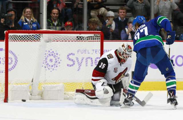 VANCOUVER, BC - NOVEMBER 17: Ben Hutton #27 of the Vancouver Canucks scores on Louis Domingue #35 of the Arizona Coyotes on an overtime penalty shot during their NHL game at Rogers Arena November 17, 2016 in Vancouver, British Columbia, Canada. Vancouver won 3-2 in overtime. (Photo by Jeff Vinnick/NHLI via Getty Images)