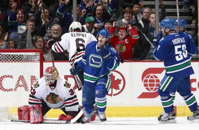 VANCOUVER, BC - NOVEMBER 19: Bo Horvat #53 watches Loui Eriksson #21 of the Vancouver Canucks celebrate after scoring on Scott Darling #33 of the Chicago Blackhawks during their NHL game at Rogers Arena November 19, 2016 in Vancouver, British Columbia, Canada. (Photo by Jeff Vinnick/NHLI via Getty Images)