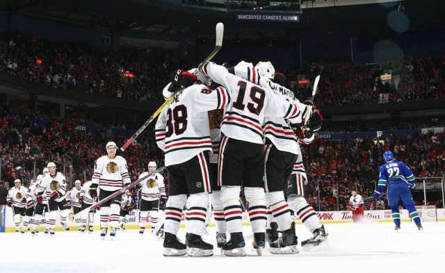 VANCOUVER, BC - NOVEMBER 19: The Chicago Blackhawks celebrate their win over the Vancouver Canucks during their NHL game at Rogers Arena November 19, 2016 in Vancouver, British Columbia, Canada. Chicago won 4-3 in overtime. (Photo by Jeff Vinnick/NHLI via Getty Images)