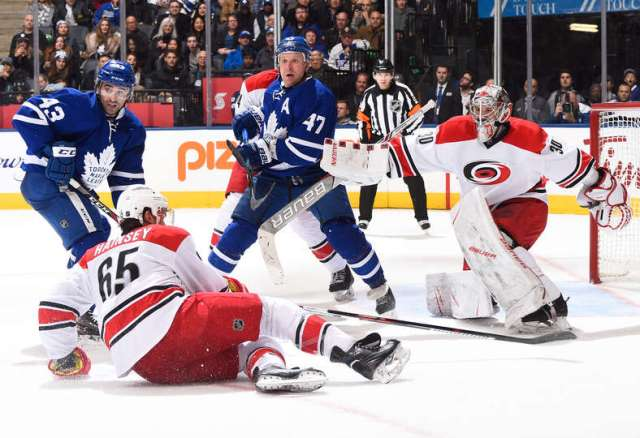 TORONTO, ON - NOVEMBER 22: Nazem Kadri #43 and Leo Komarov #47 of the Toronto Maple Leafs watch for a shot while scrambling in front of the net with Cam Ward #30 and Ron Hainsey #65 of the Carolina Hurricanes during the third period at the Air Canada Centre on November 22, 2016 in Toronto, Ontario, Canada. (Photo by Graig Abel/NHLI via Getty Images)