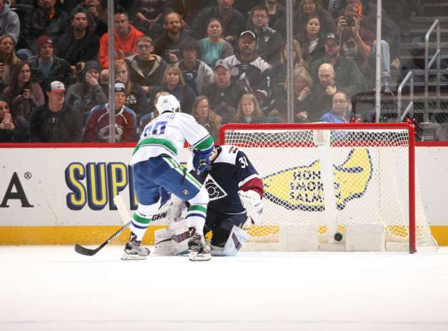 DENVER, CO - NOVEMBER 26: Markus Granlund #60 of the Vancouver Canucks scores during the shootout against Goaltender Calvin Pickard #31 of the Colorado Avalanche at the Pepsi Center on November 26, 2016 in Denver, Colorado. The Canucks defeated the Avalanche 3-2 in a shootout. (Photo by Michael Martin/NHLI via Getty Images)