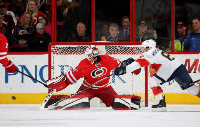 RALEIGH, NC - NOVEMBER 27: Michael Leighton #32 of the Carolina Hurricanes deflects the puck away from Jonathan Marchessault #81 of the Florida Panthers during an NHL game on November 27, 2016 at PNC Arena in Raleigh, North Carolina. (Photo by Gregg Forwerck/NHLI via Getty Images)