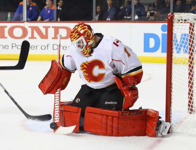 NEW YORK, NY - NOVEMBER 28: Brian Elliott #1 of the Calgary Flames makes the second period stop against the New York Islanders at the Barclays Center on November 28, 2016 in the Brooklyn borough of New York City. (Photo by Bruce Bennett/Getty Images)
