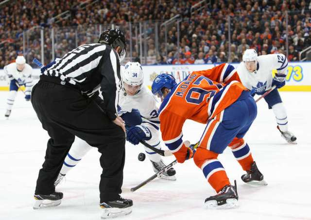 EDMONTON, AB - NOVEMBER 29: Connor McDavid #97 of the Edmonton Oilers faces off against Auston Matthews #34 of the Toronto Maple Leafs on November 29, 2016 at Rogers Place in Edmonton, Alberta, Canada. (Photo by Codie McLachlan/Getty Images)
