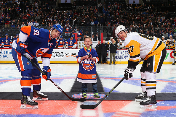 NEW YORK, NY - NOVEMBER 18:  Wyatt Maksin from the Barth Syndrome Foundation poses for a photo with John Tavares #91 of the New York Islanders and Sidney Crosby #87 of the Pittsburgh Penguins during the ceremonial puck drop at the Barclays Center on November 18, 2016 in Brooklyn borough of New York City.  (Photo by Mike Stobe/NHLI via Getty Images)