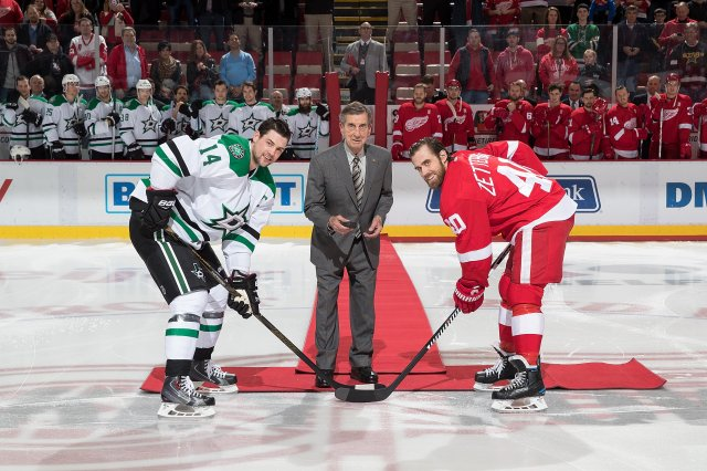 DETROIT, MI - NOVEMBER 29: Hall of Famer and former Detroit Red Wing Ted Lindsay drops the ceremonial first puck between captain Jamie Benn #14 of the Dallas Stars and captain Henrik Zetterberg #40 of the Detroit Red Wings prior to an NHL game at Joe Louis Arena on November 29, 2016 in Detroit, Michigan. (Photo by Dave Reginek/NHLI via Getty Images)