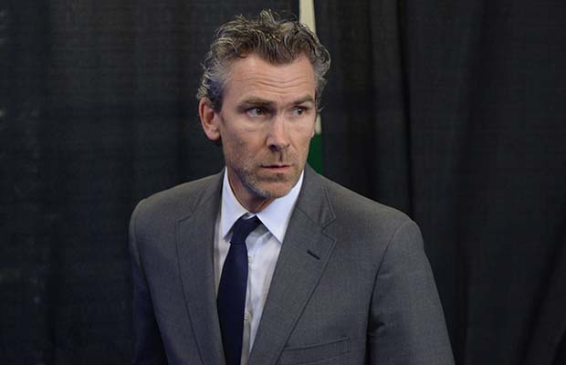 CORRECTED VERSION - CORRECTS IDENTITY - Vancouver Canucks president Trevor Linden makes his way to a news conference in Vancouver on Thursday, May 1, 2014. Linden announced that head coach John Tortorella and assistant coach Mike Sullivan have been relieved of their duties. THE CANADIAN PRESS/Jonathan Hayward ORG XMIT: CPT311