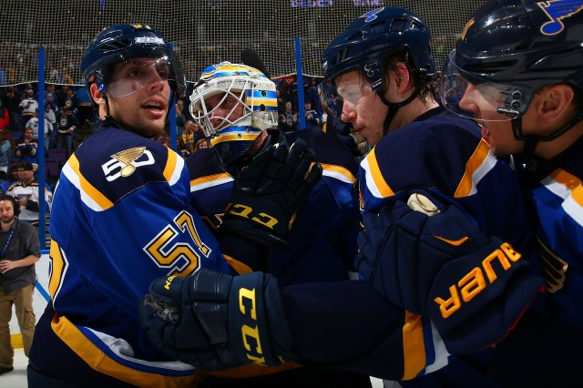 ST. LOUIS, MO - NOVEMBER 28: David Perron #57, Jake Allen #34 and Vladimir Tarasenko #91 of the St. Louis Blues celebrate after beating the Dallas Stars in overtime at the Scottrade Center on November 28, 2016 in St. Louis, Missouri.  (Photo by Dilip Vishwanat/NHLI via Getty Images)