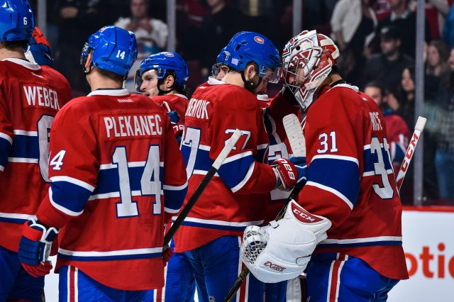 MONTREAL, QC - NOVEMBER 02:  The Montreal Canadiens celebrate a victory over the Vancouver Canucks during the NHL game at the Bell Centre on November 2, 2016 in Montreal, Quebec, Canada.  The Montreal Canadiens defeated the Vancouver Canucks 3-0.  (Photo by Minas Panagiotakis/Getty Images)