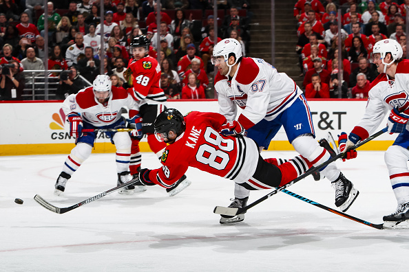 CHICAGO, IL - NOVEMBER 13:  Patrick Kane #88 of the Chicago Blackhawks shoots the puck against Max Pacioretty #67 and Jeff Petry #26 of the Montreal Canadiens, resulting in a goal in the second period, at the United Center on November 13, 2016 in Chicago, Illinois.  (Photo by Chase Agnello-Dean/NHLI via Getty Images)