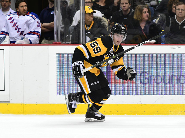 Jake Guentzel #59 of the Pittsburgh Penguins skates on the ice against the New York Rangers at PPG PAINTS Arena on November 21, 2016 in Pittsburgh, Pennsylvania.