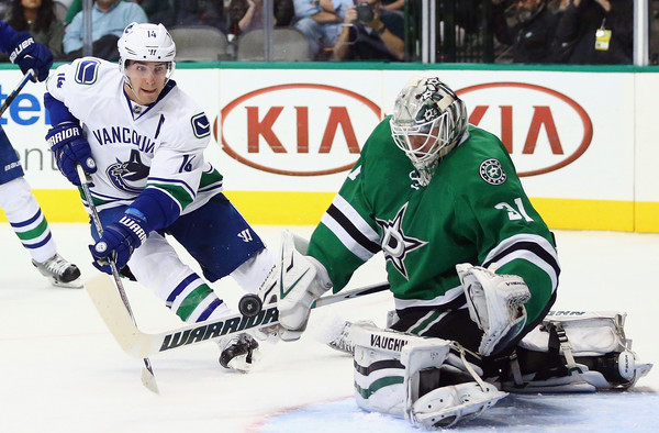 Antti Niemi #31 of the Dallas Stars makes a save in front of Alex Burrows #14 of the Vancouver Canucks in the second period at American Airlines Center on October 29, 2015 in Dallas, Texas. (Oct. 28, 2015 - Source: Ronald Martinez/Getty Images North America)