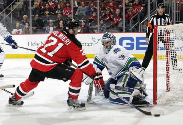 NEWARK, NJ - NOVEMBER 8: Ryan Miller #30 of the Vancouver Canucks makes a save against Kyle Palmieri #21 of the New Jersey Devils during overtime at the Prudential Center on November 8, 2015 in Newark, New Jersey. The Devils defeated the Canucks 4-3 in overtime. (Photo by Adam Hunger/Getty Images)