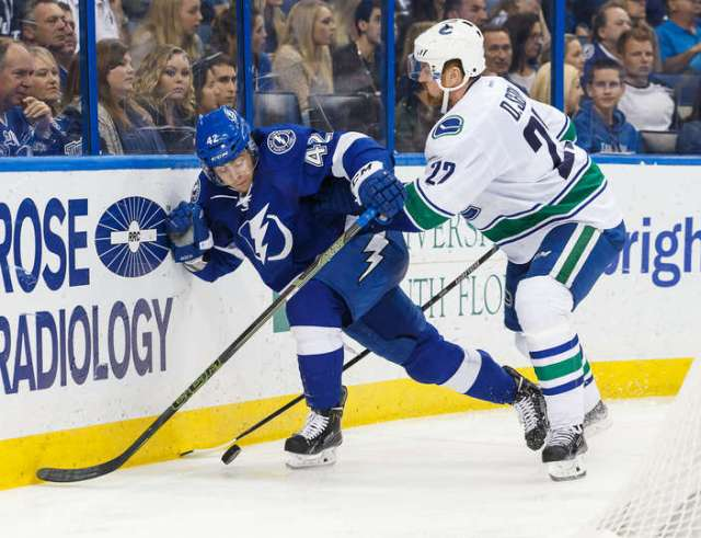 TAMPA, FL - DECEMBER 22: Jonathan Marchessault #42 of the Tampa Bay Lightning battles for the puck against Daniel Sedin #22 of the Vancouver Canucks during the second period at the Amalie Arena on December 22, 2015 in Tampa, Florida. (Photo by Scott Audette/NHLI via Getty Images)