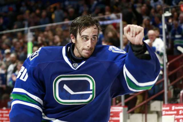 VANCOUVER, BC - DECEMBER 3: Ryan Miller #30 of the Vancouver Canucks salutes the fans after being named the first star against the Toronto Maple Leafs during their NHL game at Rogers Arena December 3, 2016 in Vancouver, British Columbia, Canada. Vancouver won 3-2 in a shootout. (Photo by Jeff Vinnick/NHLI via Getty Images)