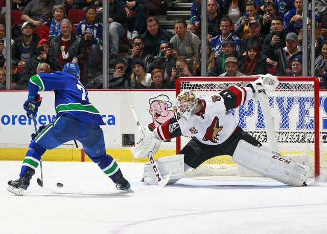 VANCOUVER, BC - JANUARY 4: v20\ backhands the puck as he scores on Mike Smith #41 of the Arizona Coyotes on a penalty shot during their NHL game at Rogers Arena January 4, 2017 in Vancouver, British Columbia, Canada. Vancouver won 3-0. (Photo by Jeff Vinnick/NHLI via Getty Images)