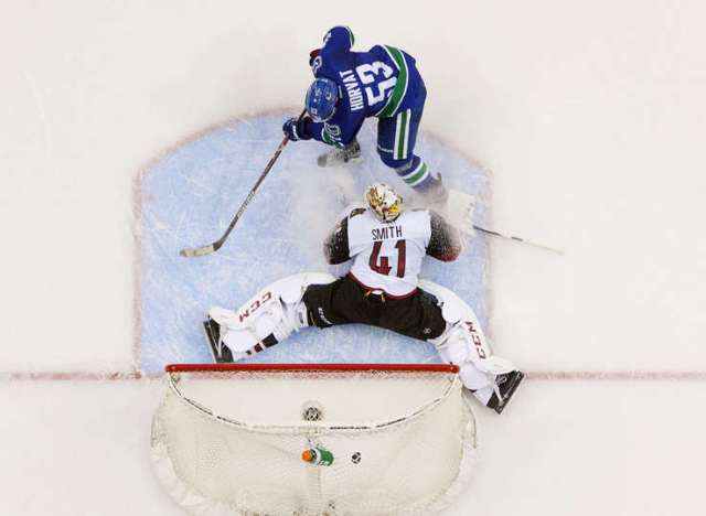 VANCOUVER, BC - JANUARY 4: Bo Horvat #53 of the Vancouver Canucks scores on Mike Smith #41 of the Arizona Coyotes during their NHL game at Rogers Arena January 4, 2017 in Vancouver, British Columbia, Canada. Vancouver won 3-0. (Photo by Jeff Vinnick/NHLI via Getty Images)
