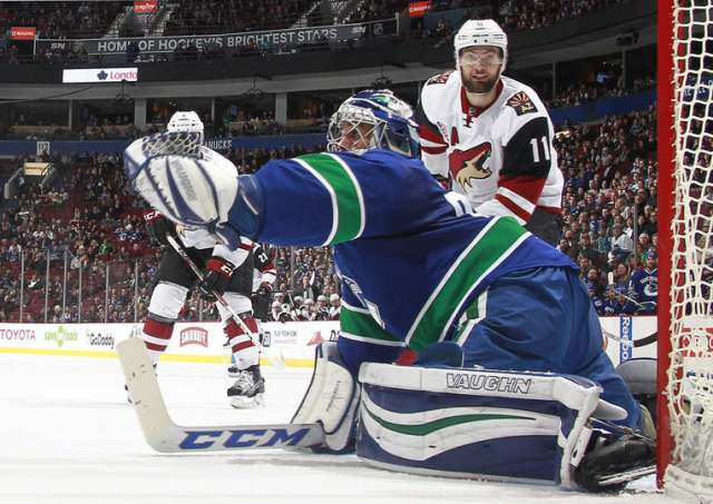 VANCOUVER, BC - JANUARY 4: Ryan Miller #30 of the Vancouver Canucks makes a glove save off the shot of Martin Hanzal #11 of the Arizona Coyotes during their NHL game at Rogers Arena January 4, 2017 in Vancouver, British Columbia, Canada. Vancouver won 3-0. (Photo by Jeff Vinnick/NHLI via Getty Images)