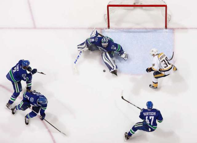 VANCOUVER, BC - JANUARY 17: Ryan Miller #30 of the Vancouver Canucks makes a save off the shot of Viktor Arvidsson #38 of the Nashville Predators during their NHL game at Rogers Arena January 17, 2017 in Vancouver, British Columbia, Canada. Vancouver won 1-0. (Photo by Jeff Vinnick/NHLI via Getty Images)