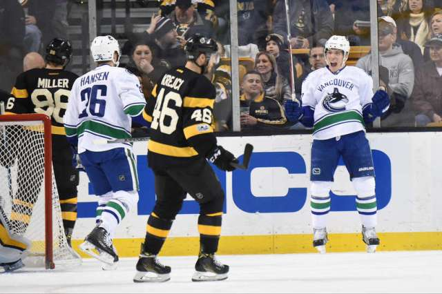 BOSTON, MA - FEBRUARY 11: Bo Hovart #53 of the Vancouver Canucks celebrates a goal against the Boston Bruins at the TD Garden on February 11, 2017 in Boston, Massachusetts. (Photo by Brian Babineau/NHLI via Getty Images)