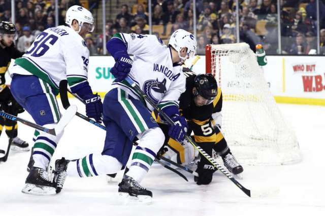 BOSTON, MA - FEBRUARY 11: Alexandre Burrows #14 of the Vancouver Canucks scores a goal past Adam McQuaid #54 of the Boston Bruins during the second period at TD Garden on February 11, 2017 in Boston, Massachusetts. (Photo by Maddie Meyer/Getty Images)
