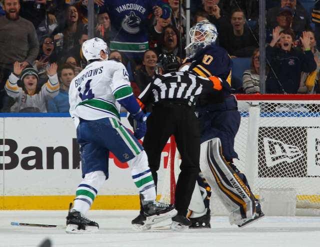 BUFFALO, NY - FEBRUARY 12: Robin Lehner #40 of the Buffalo Sabres is separated from Alexandre Burrows #14 of the Vancouver Canucks by referee Garrett Rank #7 during an NHL game at the KeyBank Center on February 12, 2017 in Buffalo, New York. (Photo by Bill Wippert/NHLI via Getty Images)